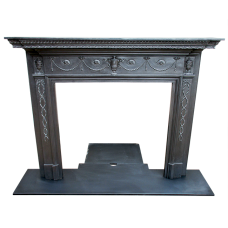 CS051 - Urn & Ribbon Cast Iron Surround (58″H x 53.25″W)