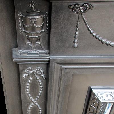 CS051 - Urn & Ribbon Cast Iron Surround (58″H x 53.25″W)
