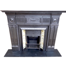 CS057 - Antique Cast Iron Fireplace Surround (55″H x 62″W)